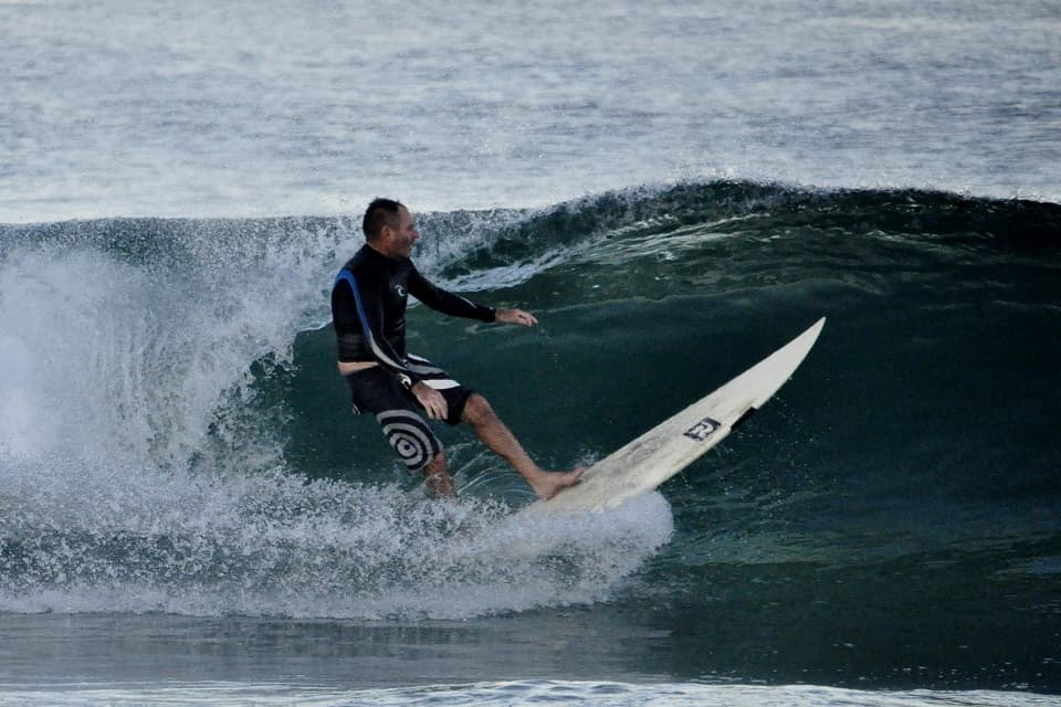 Chris Denton surfing