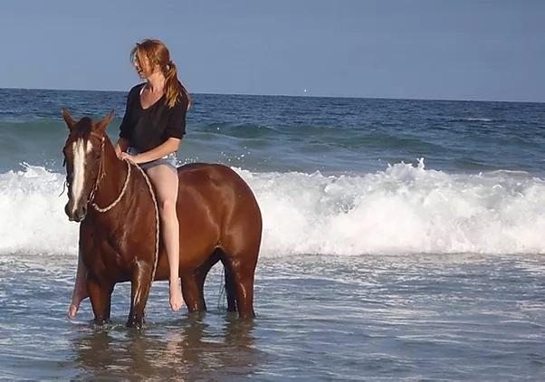 Bareback riding on the beach