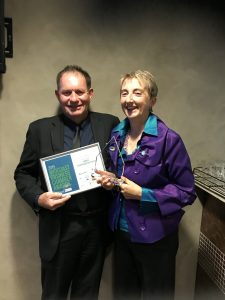 Dianne and Chris Denton holding Business Excellence Award